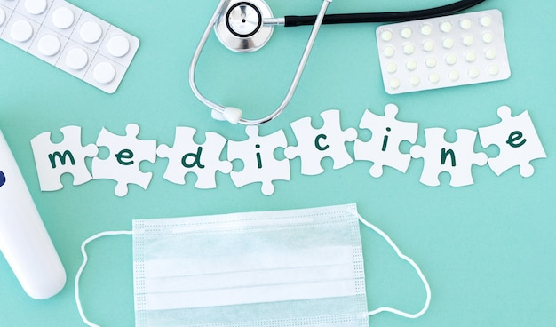Top view of medical equipment and blank puzzle pieces