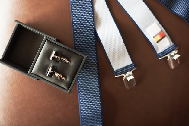Top view of men's accessories on dark