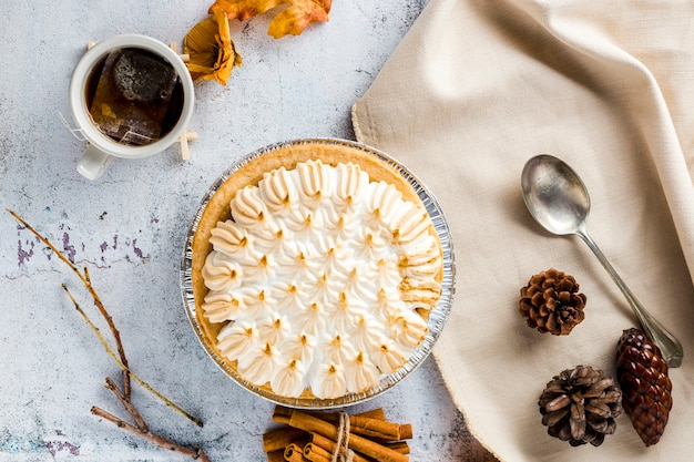 Top view meringue pie with autumn decoration