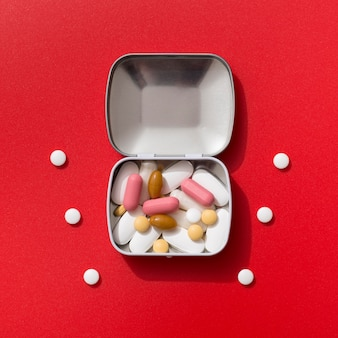 Top view of metal container with pills