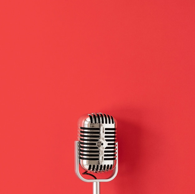 Top view microphone on red background