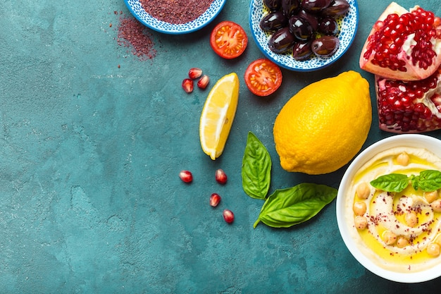 Top view of middle eastern or arab dishes and assorted snacks on concrete background