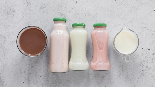 Расположение молочных бутылок сверху