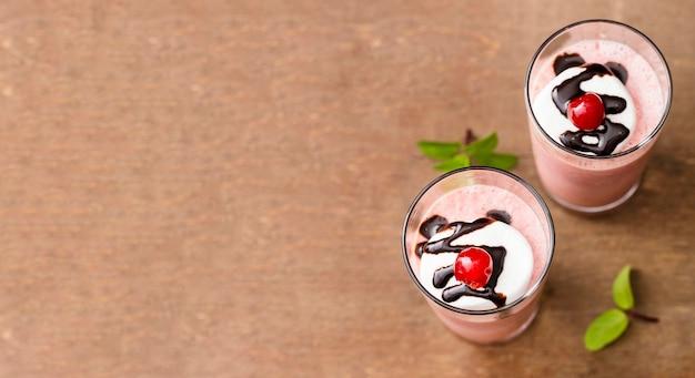 Top view milkshakes with fruits