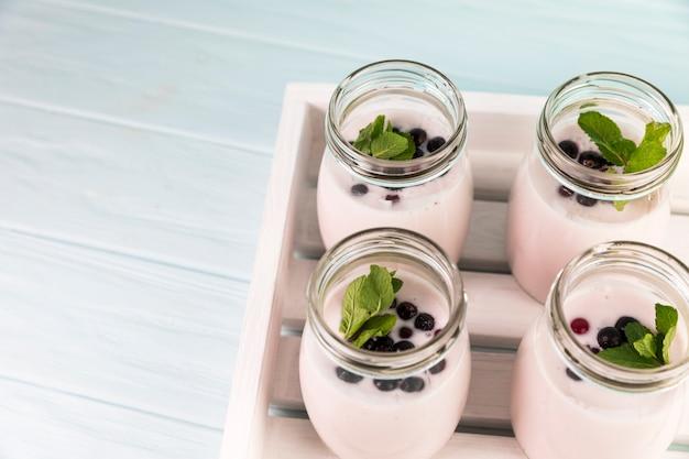 Top view milkshakes on wooden tray
