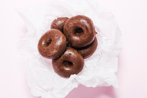 Top view mini donuts on a napkin