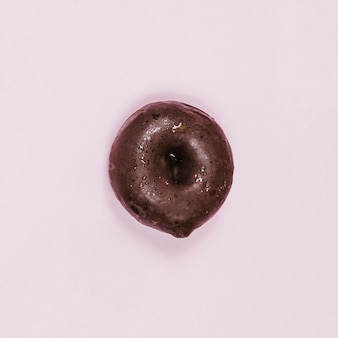 Top view mini glazed donut on pink background