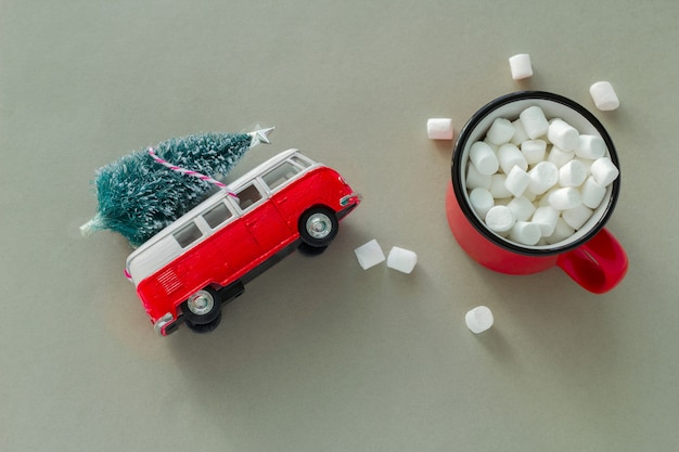 Top view minimal  flat lay with red cup with marshmallows and bauble christmas tree
