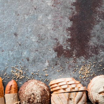Top view mix of breads with seeds and copy-space