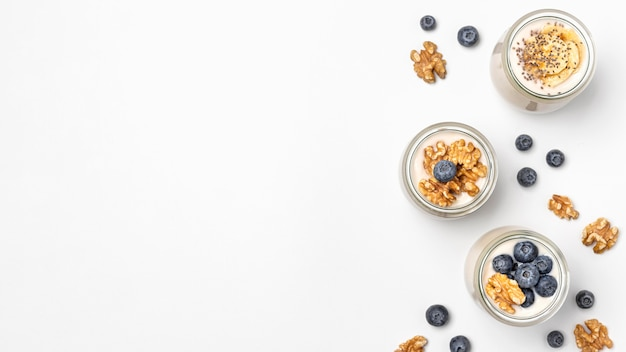 Top view mix of yogurt and fruits with copy-space