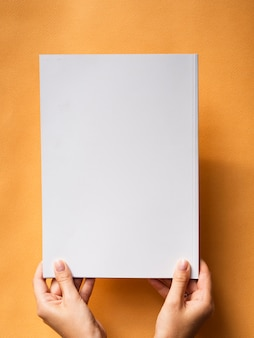 Top view mock-up magazine with orange background