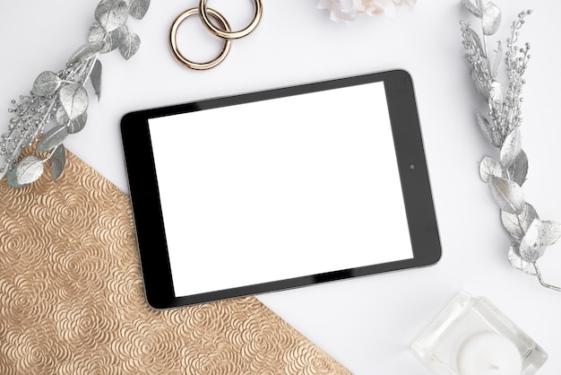 Top view mock-up tablet with wedding rings