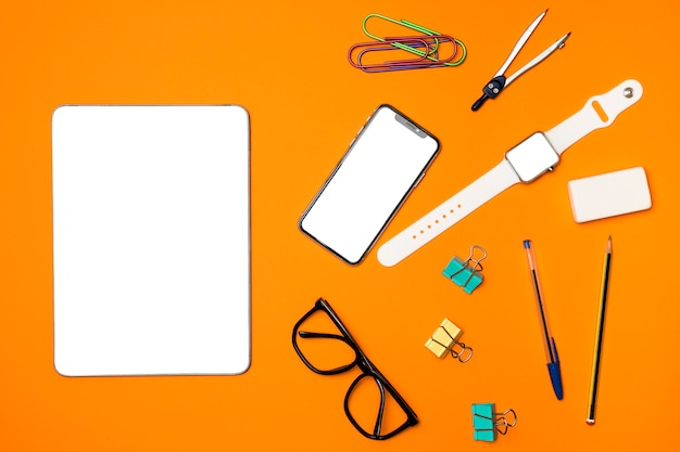 Top view mockup devices with office supplies