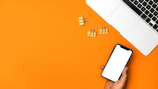 Top view mockup smartphone with orange background