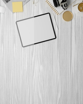 Top view mockup space on grey wooden surface with digital tablet blank screen mockup and decoration