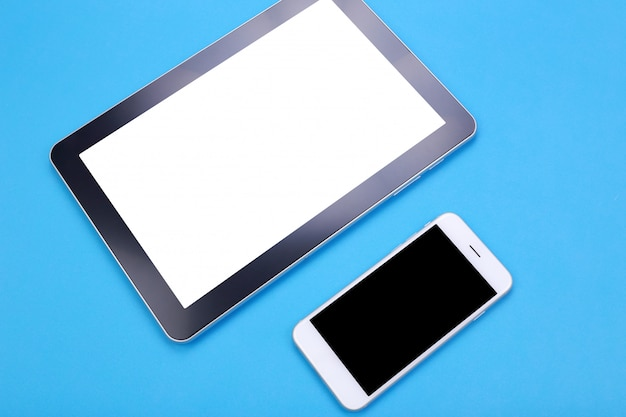 Top view mockup tablet and smartphone on blue pastel background