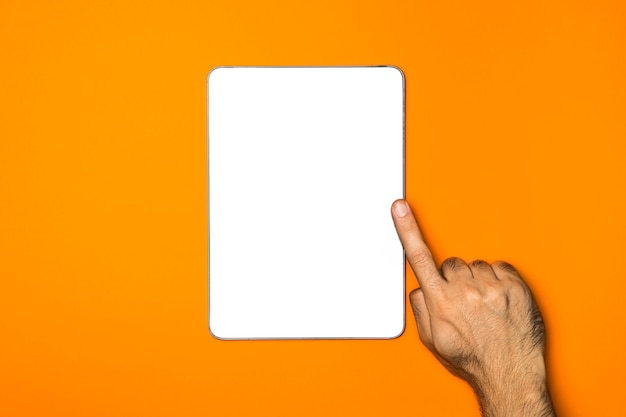 Top view mockup tablet with orange background