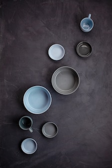 Top view of modern trendy plates in bleu and grey colors. minimalistic flat lay with tableware