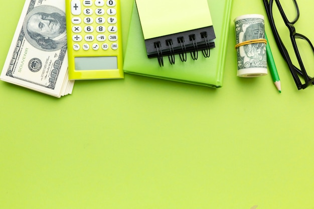 Top view money and calculator arrangement