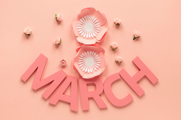 Top view of month and paper flowers for women's day