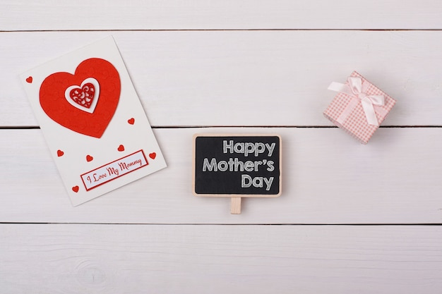 Top view mothers day concept with greeting card