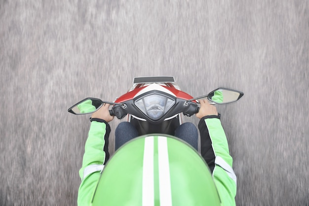 Top view of motorcycle taxi driver