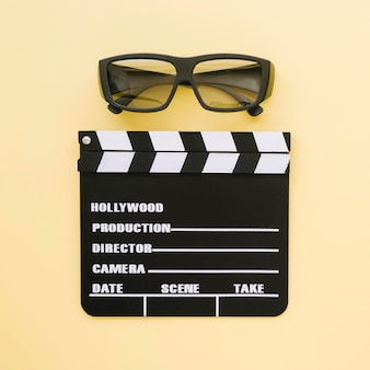 Top view movie clapperboard with 3d glasses