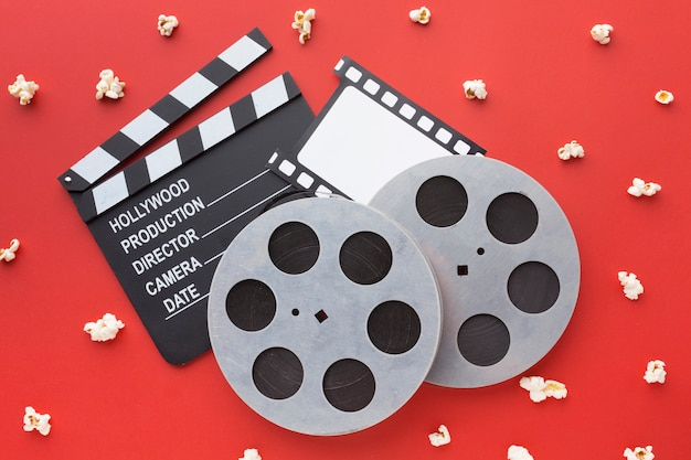 Top view movie elements on red background
