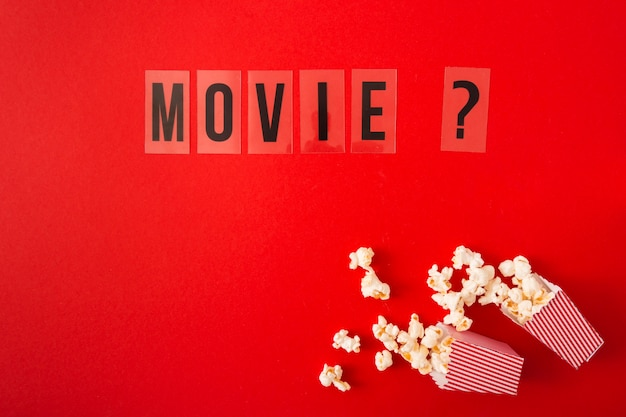 Top view movie lettering on red background with copy space