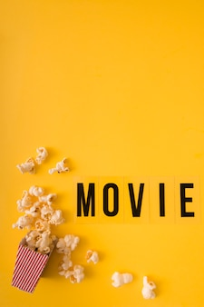 Top view movie lettering on yellow background with copy space
