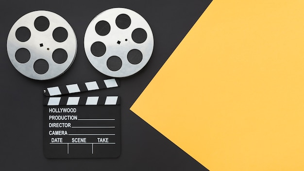 Top view movie making elements on bicolor background with copy space