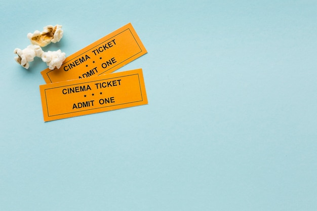 Top view movie tickets on blue background with copy space