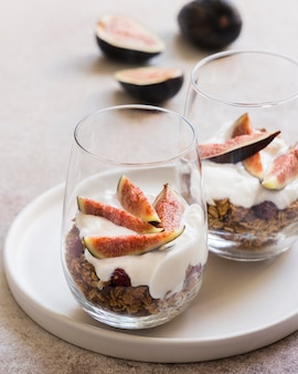 Top view of muesli with oranges in glass
