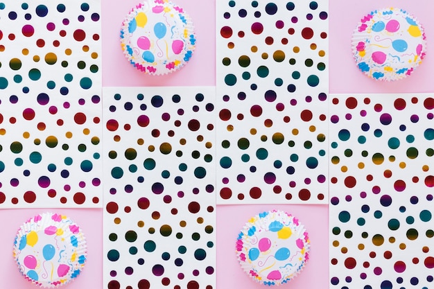 Top view muffin cups and dotted paper
