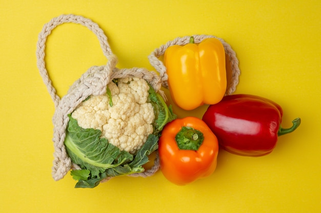 Top view multi colored bell peppers with cauliflower and cables