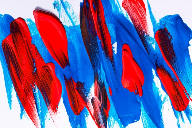 Top view of multicolored paint brush strokes on surface