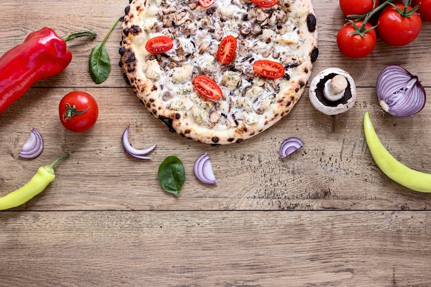 Top view mushroom and tomato pizza