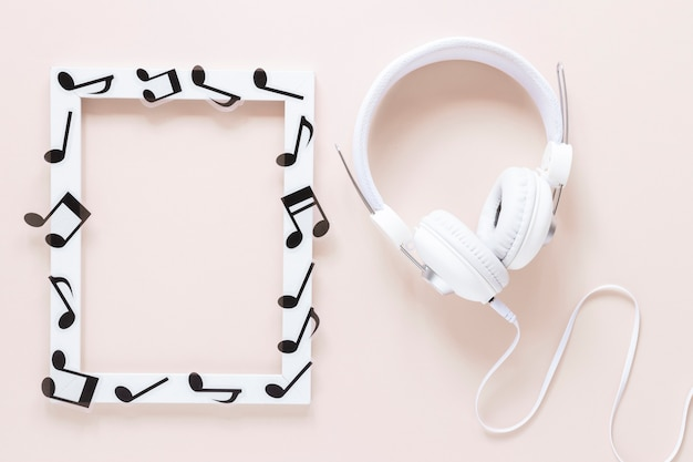 Top view musical notes frame with headset