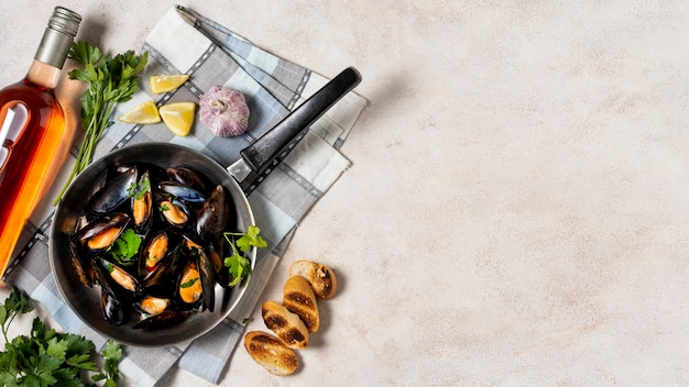 Top view mussel shells with wine