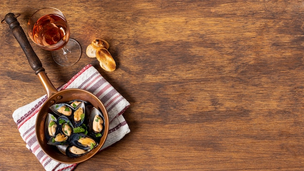 Top view mussels in a pan with copy space