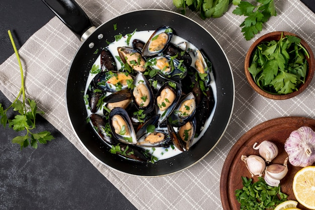Top view mussels with parsley and garlic