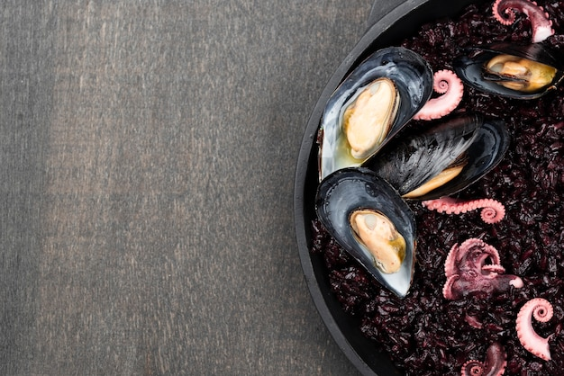 Top view of mussels with squid and copy space