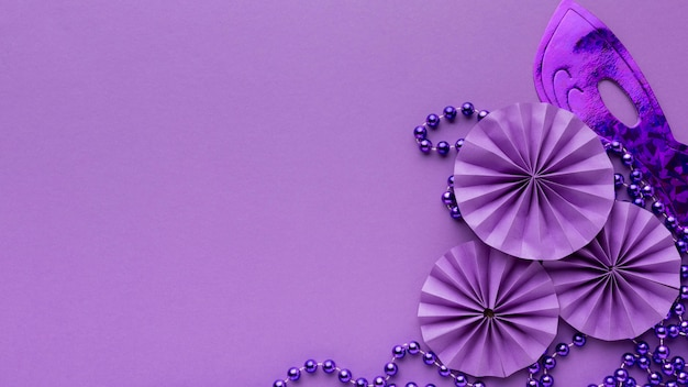 Top view mystery carnival violet decorations copy space