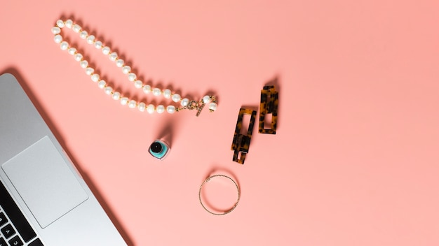 Top view of nail polish and accesories on plain background