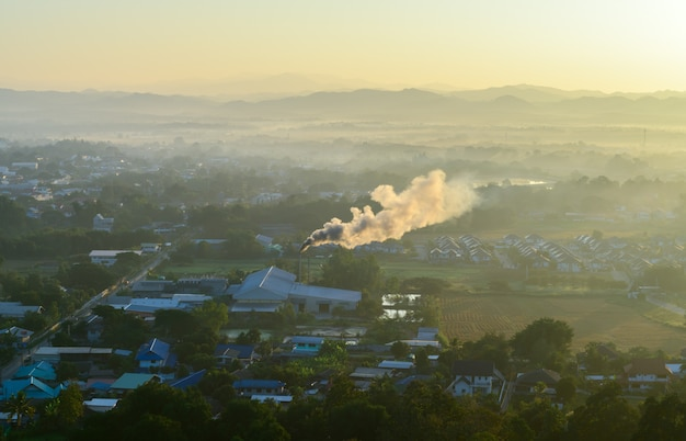 Top view of nan province and toxic smoke drifts from the factory shaft. air pollution