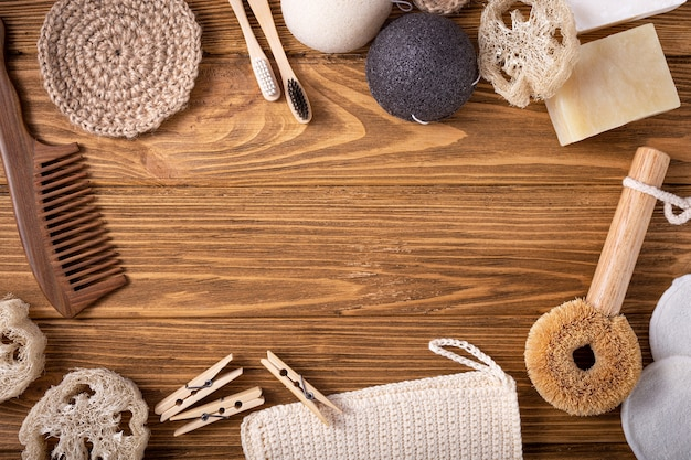 Top view of natural kitchen and bath products, zero waste life concept. set of eco-friendly accessories: bamboo toothbrush, sisal brush, wooden cotton buds, luffa, sponge konjac. space for text