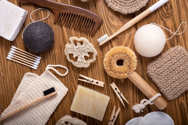 Top view of natural kitchen and bath products, zero waste living concept. set of eco-friendly accessories: bamboo toothbrush, sisal brush, wooden cotton buds, soap bar, luffa, sponge konjac