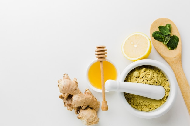 Top view natural treatment with honey and herbs