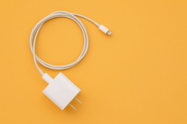 Top view new white smartphone charger