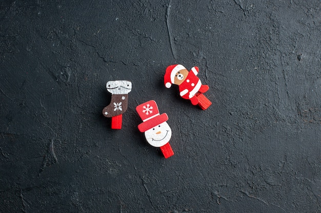 Top view of new year decoration accessories on black surface
